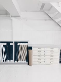 studio, office space, file cabinet, workspace, white drawers, white walls, interiors