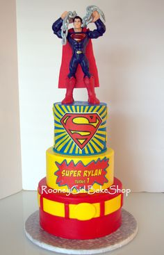 Superman Birthday Cake - Superman 1st birthday cake. Superman is a toy with gumpaste chain. Cake is all fondant. S and name are edible images.