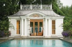 Palladian style poolhouse with double columns, eyebrow style transom window, corrugated metal flared hip roof (I die), and fretwork that could kill me (again, I DIE). Outdoor Rooms, Outdoor Living, Outdoor Decor, Porches, Enchanted Home, Cool Pools, Pool Houses, Pool Designs, Plein Air