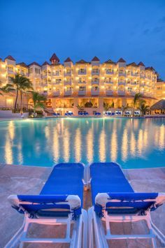 Caribbean, Dominican Republic. Barcelo Punta Cana all inclusive resort at twilight with reflections in pool.