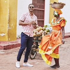 We took our Spring Collection for a jaunt in Cartagena, Colombia. | Hit the link in bio to see over 300 new products - coconuts not included.  shirt || Riviera Short Sleeve Shirt - Pink Ikat pants || Nomad Jogger - Navy