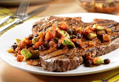 Tijuana T-Bones Recipe - Hot off the grill, this steak sizzles with the flavor of a marinade and a kicked-up salsa, featuring avocado, cilantro and black beans. It's an easy and delicious way to impress your guests. Roast Beef Recipes, Grilling Recipes, Cooking Recipes, Lamb Recipes, Entree Recipes, Mexican Food Recipes, Campbells Soup Recipes, Great Recipes, Favorite Recipes