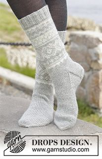 """Silver Dream Socks - Knitted DROPS socks with Norwegian pattern in """"Karisma"""". Size 35 to 46 - Free pattern by DROPS Design Knitted Boot Cuffs, Knitted Slippers, Knit Mittens, Knitting Socks, Knitting Patterns Free, Free Knitting, Crochet Patterns, Free Pattern, Drops Design"""