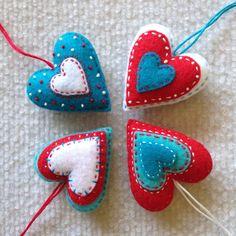 Felt heart ornaments in aqua, red and white. Set of 4