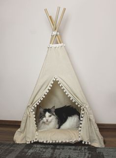 DIY Cat Teepee - I built a teepee for my cat -  Inspired by minicampLT http://etsy.me/2yvhIUM #cat #diy #teepee #catinterior #tipi