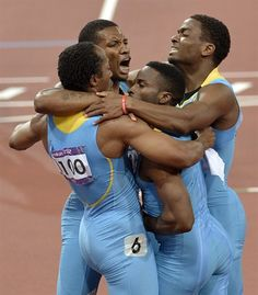 Bahamas' men's relay team Chris Brown, Demetrius Pinder, Michael Mathieu and Ramon Miller celebrate their victory. Trinidad and Tobago won the silver, while Great Britain took the bronze. Nbc Olympics, 2012 Summer Olympics, Long Jump, High Jump, Triple Jump, Pole Vault, Brothers In Arms, Track And Field, Olympians