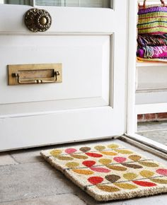 Orla Kiely doormat. Could be a good pattern to try with that stencil doormat approach.