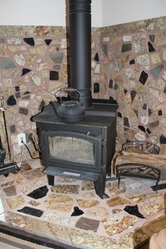Fireplace surround created with granite scraps! My ingenious husband's wonderful work!!!