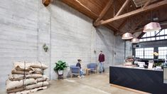 Coffee roasting and tasting takes place in this industrial-style coffee shop in Vancouver, which local studio Alice D'Andrea has designed inside a historic factory building. Industrial Windows, Industrial Style, Vancouver, Wooden Beams Ceiling, Coffee Counter, Tokyo Design, Alice, Copper Pendant Lights, Bar Interior