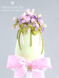 Roses and Violets Easter Egg Cake Easter Egg Cake, Easter Egg Crafts, Easter Cupcakes, Easter Cookies, Chocolates, Roses And Violets, Happy Easter Wishes, Single Tier Cake, Cake Writing