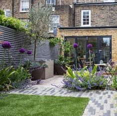 A small family garden in South London with a water feature and a hidden ch Small Courtyard Gardens, Small Courtyards, Small Backyard Gardens, Small Backyard Landscaping, Small Gardens, Outdoor Gardens, Small Garden Planting Ideas, Landscaping Ideas, Small Back Garden Ideas