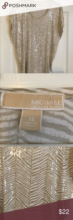 Michael Kors zebra print sequin sparkle Blouse XS playful and sparkly MICHAEL by Michael Kors sequin Blouse. Women's Size XS. Tan and white zebra print underlay with clear sequins on top. Really gorgeous! Great condition. Michael Kors Tops Blouses