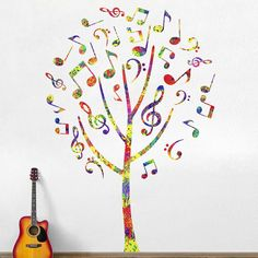 "Fresh and Funky! Our stunning Music Note Tree Wall Decal is a must have for the modern musician and music lovers alike. Jazz up your decor by displaying this colorful music tree in your classroom, music studio, library, kids' room, living room, hallway, bathroom and more! Available in 2 sizes: Medium 50""w x 71.5""h and Large 66.25""w x 94.5""h, this musical-themed sticker is ultra-easy to install! Our wall decals peel easily and stick to any flat surface, as they are made with SafeCling, a high"
