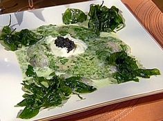 Poached Oysters in Herbsaint Cream with Black Pepper Creme Fraiche, Beluga Caviar, and Fried Spinach recipe from Emeril Lagasse via Food Network