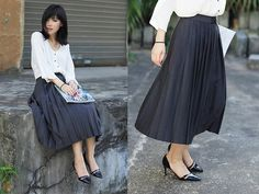 the new style by the young woman in dark gray skirt and white blouse color