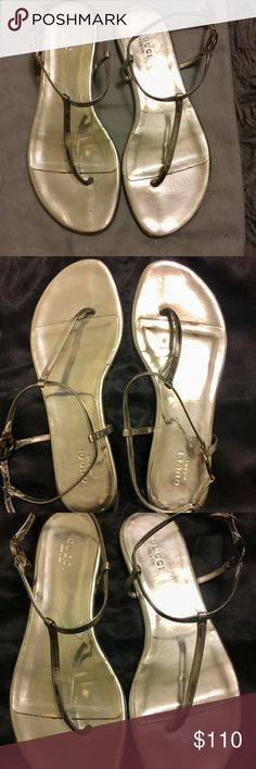Gucci thong sandals Used metallic silver sandals but still in good wearable condition . Slightly faded in soles Gucci Shoes Sandals