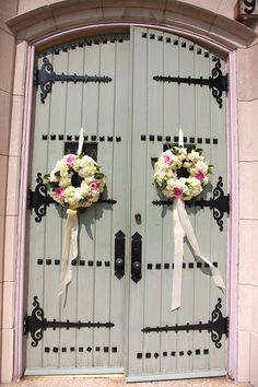 fluffy floral wreaths on the doors