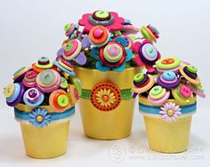 Oh my gosh -- these are so adorable! Button Flower Topiary Trio from Buttons Galore.
