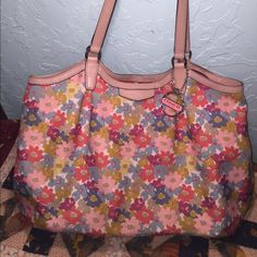 """DO NOT BUY(trade w/prayon) EXTRA LARGE AUTHENTIC COACH FLORAL PRINT SHOULDER BAG#F28931 EXCELLENT CONDITION NO WEAR AT ALL Multi-Color Floral print canvas exterior with tan leather trim  2 Inside zips, cell phone and multifunction pockets Dogleash closure, orange fabric lining Handles with 11"""" drop Measures approx: 18""""Ł x 13""""H x 7""""W.                This is a beautiful and very clean bag with only a few small stains around the inside zip pocket Coach Bags"""