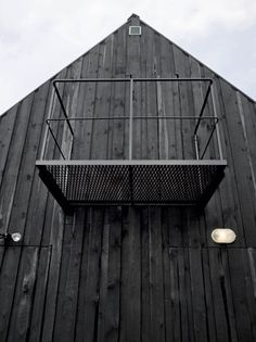 barn + black + balcony