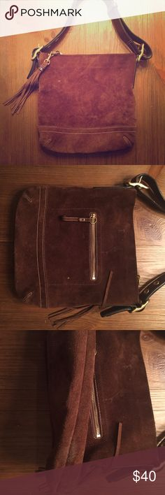 Brown Suede Leather Coach Purse Gorgeous Coach tote! The leather is beautiful! Wonderful condition. There are some marks on the leather that could be cleaned. Gorgeous tassel detail. •No returns, no trades •10% discount on 3+ items Coach Bags