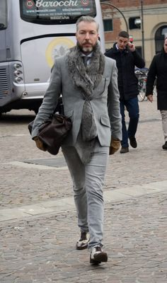 Street style Pitti Uomo 85. Gents, please do not button your fur under your jacket quite in this way. Love the idea though ;)
