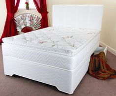 "6ft Savoy Pocket Sprung Pillowtop Divan Set - £954.95 -  has been developed to be of  medium feel but with outstanding support due to the individual hand nested pocket spring system. This offers maximum support without being firm and also gives you a true ""no roll together"" mattress. The mattress is upholstered in a beautiful soft fabric and is vented for superior air circulation along with flag stitched handles.  The base is upholstered in a matching fabric"