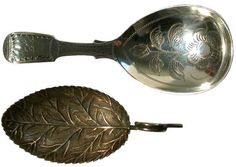 25      A George III silver leaf caddy spoon with ring terminal by Joseph Willmore, Birmingham 1813; together with a fiddle pattern 'bright cut' caddy spoon, the oval bowl decorated with a flowering shrub, contemporary initials, London 1821, maker's mark H.D. over C.D.