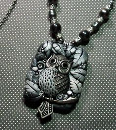I made the pendant from polymer clay and included a cute little owl charm.