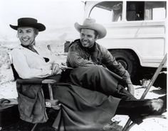 """Audie sits with Joan O'Brien on the set of """"6 Black Horses."""""""
