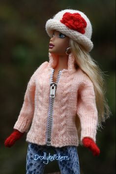 Hand Knit Zippered Sweater Jacket with cable design and high collar.  The zipper is a separating one.  Hand knit felted hat with rolled brim and felted flower accent.  Hand knit exclusive mittens with thumb.  Hat is designed to fit My Scene, Bratz, and Liv doll size heads.