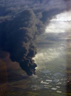100 Incredible Views Out Of Airplane Windows - Fuel depot explosion in 2006. London, England.