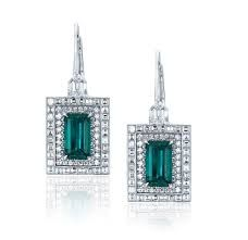 EMERALD AND CARRE-CUT DIAMOND EARRINGS Emerald-cut emeralds of carats accented with 2 bullet shape diamonds; channel set with 64 carre-cut diamonds of carats and micro-set with 112 round diamonds. Set in white gold. Sharon Stone, Jennifer Aniston, Jewel Tone Decor, Emerald Earrings, Tourmaline Earrings, Drop Earrings, Titanic Jewelry, Diamond Stores, Blue Chalcedony