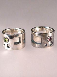 Mondrian ring.  Silver and peridot or garnet.