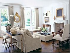 The arrangement of this  California living room by Betty Burgess has many of the key ingredients for comfortable conversational seating:  1.  A not-too-big sofa (avoiding that middle-seat syndrome).  2. An upholstered, yet moveable, armchair.  3.  An ottoman doubling as a coffee table.  4.  A long bench with a beefy cushion (bonus-it doesn't block the view of the garden.)  5. Extra seating tucked under the console, just waiting to be called into service.  6.  All seating is at roughly the…