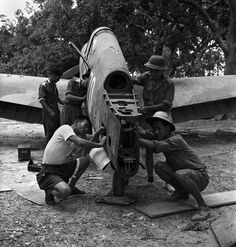 Burma World War 2: The Flying Tigers, 1942. Chinese ground crew at work on a damaged tail of Curtis P-40. George Rodger.