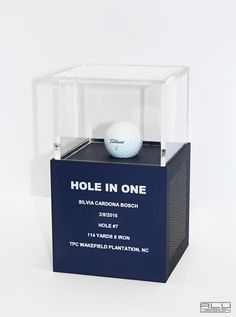 Delux HOLE IN ONE Golf Ball Display Case for your ACE CNC Machined Anodized Aluminum with Black Carbon Fiber Design. Golf Trophy Cases, Hole In One Plaques. Modern Golf Displays and Trophies. Made in the USA. Order online shipping worldwide. modern golf accessories