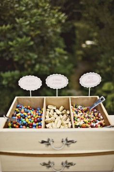 old drawer used for candy table or trail mix stand while people wait for the reception to start:)