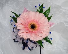 Pink gerbera daisy corsage with outlined blue ribbon and blue rhinestone accessories  #prom #promflowers #prom2014