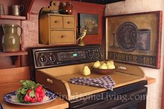 Apartment Decorating Ideas: Turn your electric stovetop into counter space when you're not using it by covering it with this wooden stovetop cover. It expands the work area in a small kitchen. Just make sure you don't turn on the stove while the topper is in place.