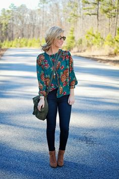 floral top with jeans and brown boots fall fashion