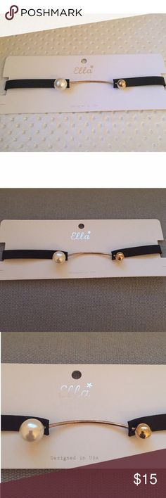 "Faux Pearl Black Choker w/ Gold Ball & Bar NWT Black faux leather/vinyl choker w/ faux pearl, gold tone bar & ball. What's different about this choker is that the enclosure is in front. Twist the gold ball to detach. Please check measurements since it's important to fit neck since there is no extension/chain clasp. Overall length incl. the gold bar is 14-3/8"". Choker is 3/8"" wide. Gold bar is slightly burnished w/black. See pics. Not noticeable when worn. Purchased directly from supplier…"
