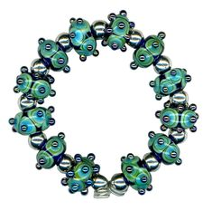 Handmade USA Lampwork Glass Beads Blue Teal Triton Raised Dot Double Helix Beads by WatkinsStudio on Etsy https://www.etsy.com/listing/97777596/handmade-usa-lampwork-glass-beads-blue