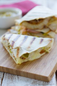 Cuban Quesadilla Recipe - this recipe is for hearty quesadillas that are filled with all of the flavors of a Cuban sandwich - pork, ham, pickles, mustard and cheese.