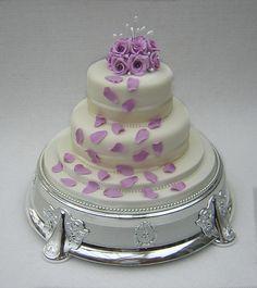 Lilac petals on #wedding cake.