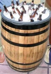 DIY:  Drink Cooler - insert a plastic tub in the top and fill with ice and drinks - that's the tutorial! + lots of great ways to reuse barrels - via Kentucky Barrels