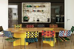 A kitchen furnished with India's 'Double Diagonale' table and Franz West chairs