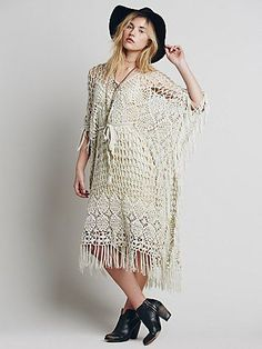 Adrift Kaftan | Designed in Australia, this handmade crochet kaftan is a bohemian dream. Shapeless with fringe detail and high side slits; features an illusion nude slip.  *By Zulu & Zephyr