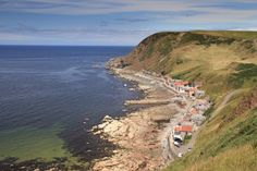 (PHOTO: Getty) Britain's most picturesque villages  Crovie, Aberdeenshire, Scotland  A remote, single line of houses make up the tiny fishing village of Crovie. The village curls itself around the base of the cliffs that form the east side of Gamrie Bay and boasts uninterrupted views of the wild Scottish coastline. Adding to Crovie's charm is the complete lack of vehicles, the road is simply too narrow to accommodate them!