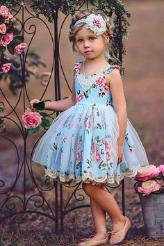 Flower girl dresses don't have to be white or pink or even solid colors! This adorable floral flower girl dress is perfect for a spring, summer or boho-chic wedding. Dollcake Dresses, Baby Tutu Dresses, Little Girl Dresses, Baby Dress, Girls Dresses, Long Dresses, Flower Girl Dresses Boho, Girls Blue Dress, Lace Flower Girls